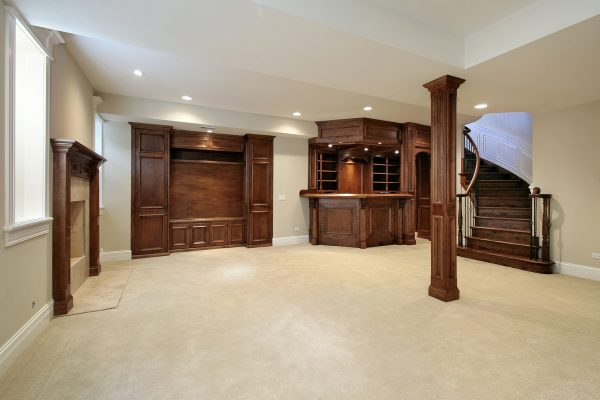 Basement in new construction home with wood cabinetry